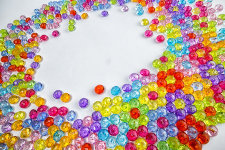 Background of colored beads on a white background