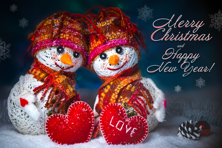 Love snowmen. Snowfall. Love concept. Greeting card Merry Christmas and happy new year Imagens