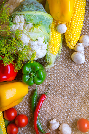 vegetables, vegetables on the table. corn, cauliflower, tomatoes, champignons, chili peppers Stock Photo
