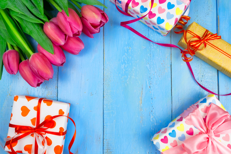 Pink tulips on wooden blue background. Conception holiday, March 8, Mothers Day. Flat lay and copy space
