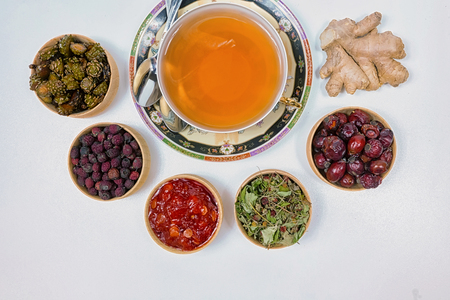 tea for health, ginger tea, flax, grass, strawberries, cones, hawthorn, canina-rose