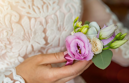 Brides hands with a bouquet for the groom. place for text