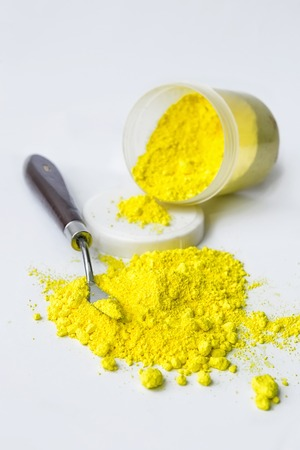 Cadmium Yellow medium pigment on a white background Stock Photo