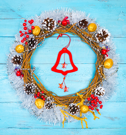 Christmas beautiful wreath on a wooden table, New Year decoration,
