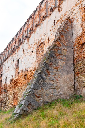 The old ruins of the collapsed walls with gates and windows Staroselskiy castle in Stare Selo in the Lviv region in Ukraine