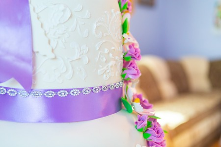 cake decoration. beautiful wedding cake with purple orchids. cake in violet tones