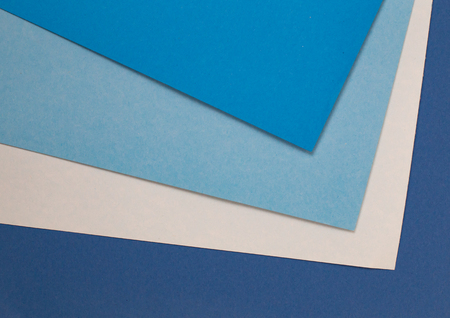 sheets of colored paper. Many colored sheets of paper are laid out in the harsh composition. background of colored paper. place for text. view from the top 写真素材