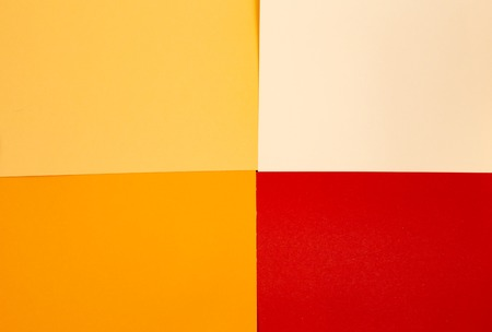 sheets of colored paper. Many colored sheets of paper are laid out in the harsh composition. background of colored paper. place for text. view from the top Stock Photo