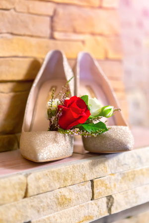 stylish wedding attributes of the brides butanes shoes.