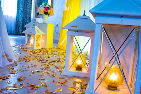the decor of the photoson at the wedding with decorative lanterns that glow