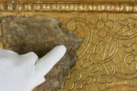 gold with carvings on the old icon. restoration of the icon, gold restoration, old icon, old painting, restoration. conservation of paintings