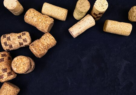 wine corks on a black textured surface. top view. place for text Фото со стока