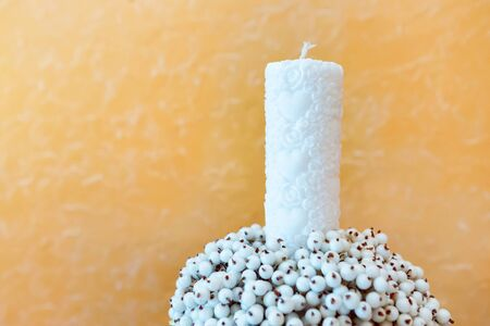wedding decor. candle and artificial sugar berries. snow bush berries.