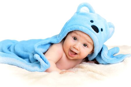 smiling baby boy on a white background. place for text