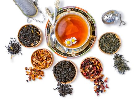 different types of tea on a white background. a kind of delicious tea, fruit tea. top view. place for text, isolated on white Фото со стока
