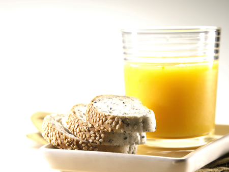 Wholemeal bread and a glass of orange juice