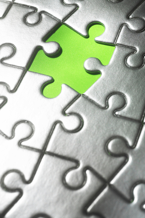 One piece missing from an assembled jigsaw puzzle Standard-Bild - 117639326