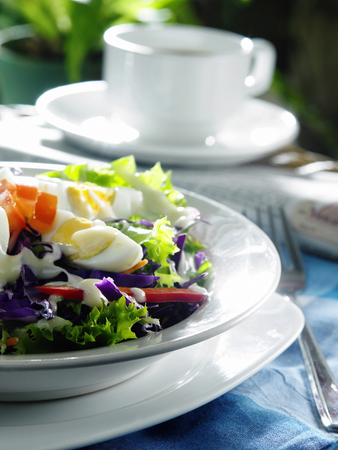 A big plate of salad for a relaxing morning