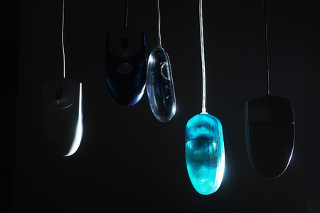 Studio shot of hanging computer mouse