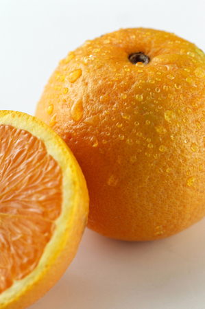 Studio shot of a full and a half orange
