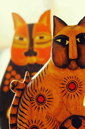 Studio shot of wooden cats as decorative item
