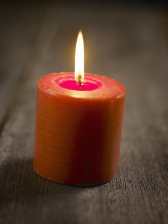A lit red candle