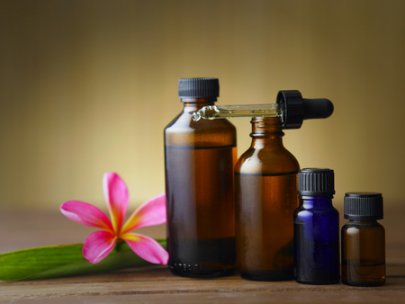 aromatherapy bottles with flower Stock Photo - 117717439