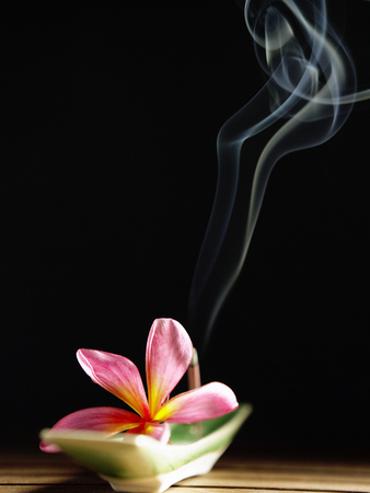 smoke coming out from a burning incense