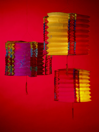 3 lanterns with red background