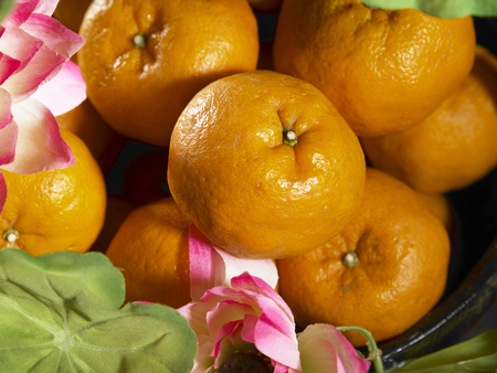 top angle of madarin oranges with lotus