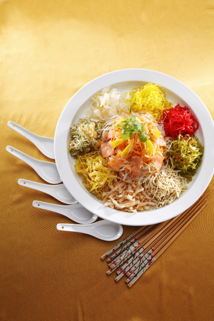 yusheng with cutlery Фото со стока