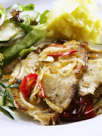 pork slices,salad and mash potato are ready to eat Foto de archivo