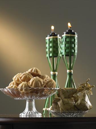 malaysia tradition food bahulu and ketupat on the glass plate Stock Photo
