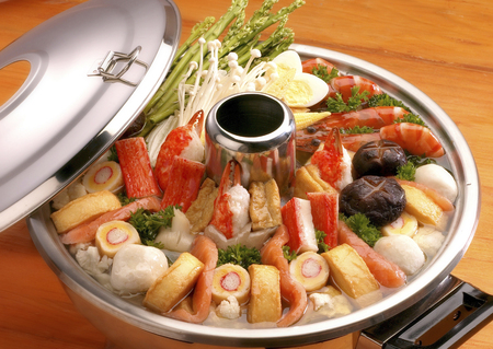 Steamboat on a wooden table.