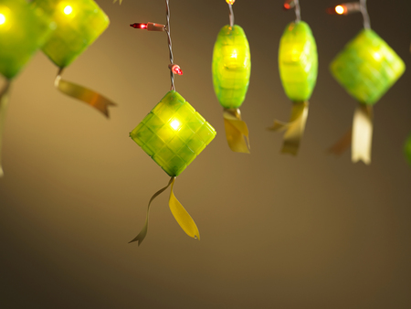flash light and ketupat light on the orange background