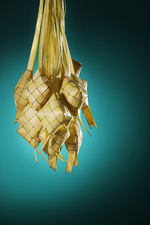 group of hanging ketupat with green background Stock Photo