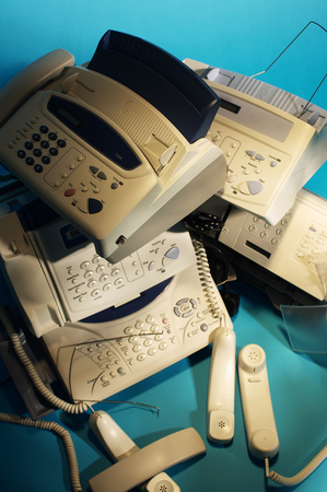 Top view of stack of fax machines Stock Photo