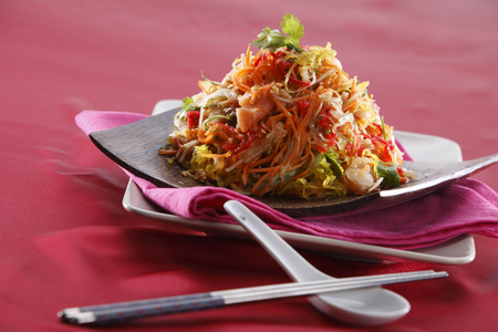 yusheng  with chopstick and spoon