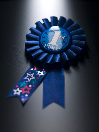 Number one medal on a blue ribbon