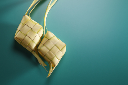 two ketupat with green background