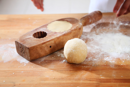 casting moon cake using traditional wooden mold