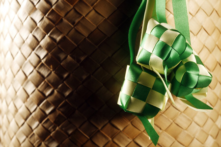 decoration ribbon ketupat at the checker mat