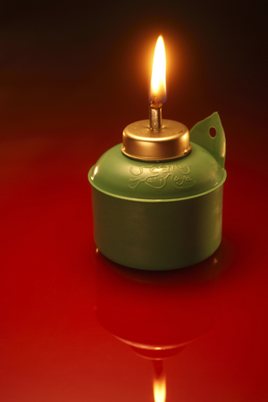 pelita with reflection on red background