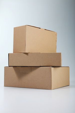 few boxes stacked on the plain color background Banco de Imagens - 117873211