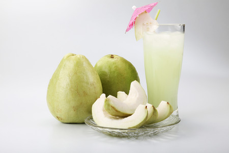 guava ,slice and drink on the plain background