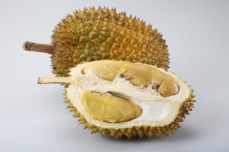 durian and a half on the plain background 版權商用圖片