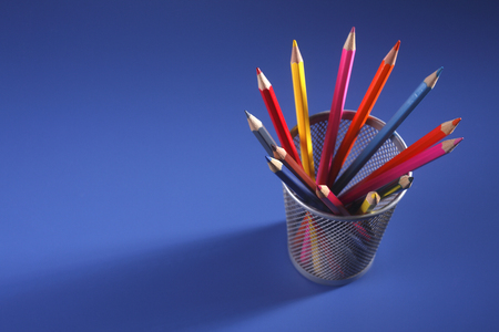 group of the color pencil on the blue background Imagens