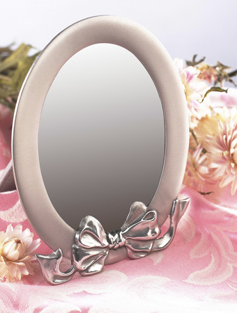 Pink mirror with some flowers.