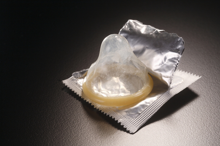stock image of open pack of condom