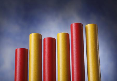 A few cylinders representing a graph. Reklamní fotografie - 118513741